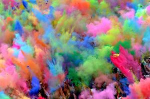 JULY 29: People throw colored powder into the air during the Holi Festival in Berlin. The original Holi, also known as the festival of colors, is a festival celebrated in India and other Hindu countries. Some thousands of people celebrated this event with Indian Djs, acrobatics and dance in the German capital. (Oliver Lang/dapd)